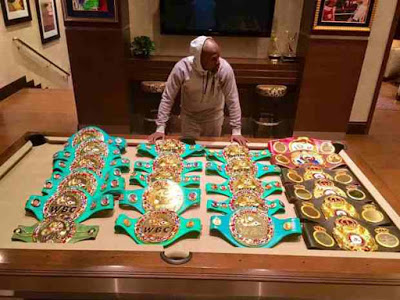 Check this Out: Floyd Mayweather and His Prized Belts
